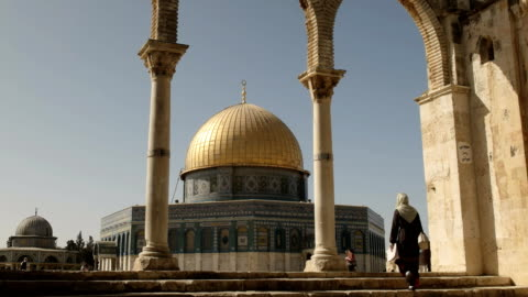 a woman climbs steps towards the dome of the rock, jerusalem a woman climbs steps towards the dome of the rock mosque in jerusalem, israel ancient stock videos & royalty-free footage
