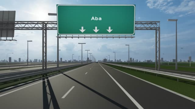 aba city signboard on the highway conceptual stock video indicating the entrance to city - nigeria video stock e b–roll