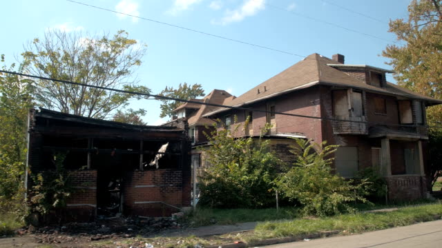 CLOSE UP: Abandoned decaying homes and burnt buildings in deteriorating town video