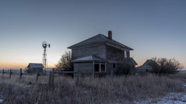 Abandoned farm time lapse Sunrise timelapse of an abandoned farm house on the canadian prairies during winter. the past stock videos & royalty-free footage