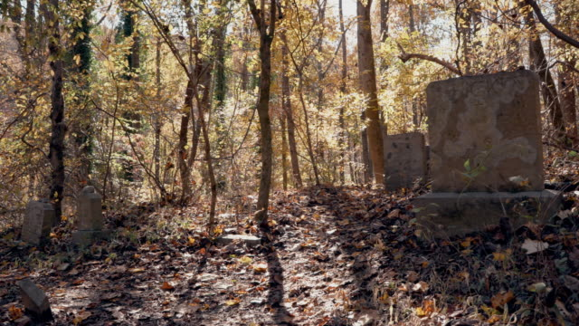 Abandoned Graveyard in Ghost Town During Autumn - Old Tombstone and Grave