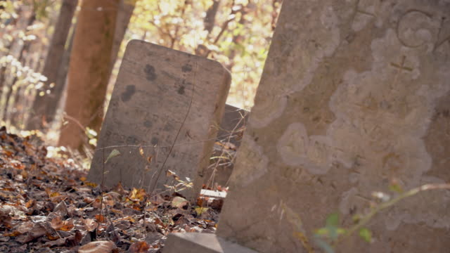 Abandoned Graveyard in Ghost Town During Autumn - Old Tombstones and Graves
