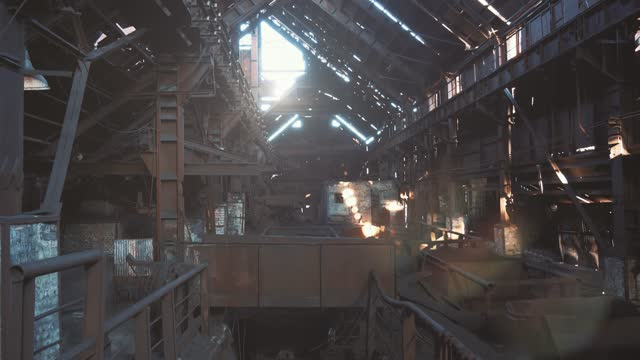 Abandoned hangar of old rusty industrial metallurgical factory, atmosphere of destruction and post-apocalypse video