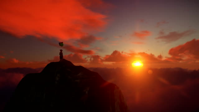 Abandoned little girl holding balloons on top of a mountain above clouds against beautiful sunset, 4K
