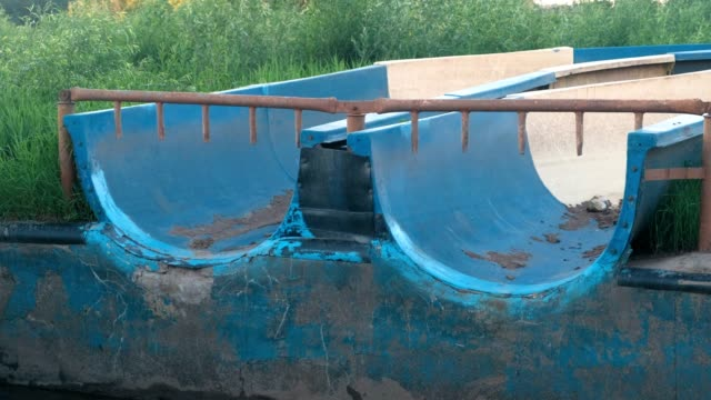 Abandoned slides in the outdoor water Park in the summer