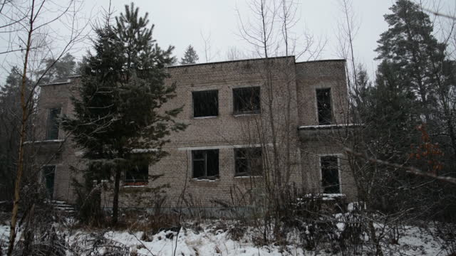 Abandoned two-story brick building in the forest video