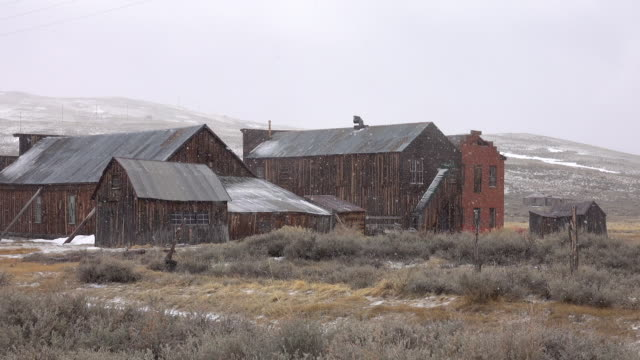 Abandoned wooden houses in Bodie, Nevada, weathering the cold winter conditions.