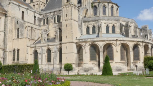 Abbaye aux Hommes famous William the Conquerer abbey church by the day 4k Abbaye aux Hommes famous William the Conquerer abbey church by the day 4k 3840X2160 slow tilt UltraHD footage - The Mens Abbey located in city of Caen of France in Normandy 4K 2160p UHD video caen stock videos & royalty-free footage