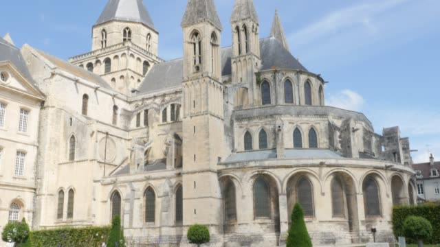 Abbaye aux Hommes famous William the Conquerer church by the day 4k Abbaye aux Hommes famous William the Conquerer church by the day 4k 3840X2160 slow tilt UltraHD footage - The Mens Abbey located in city of Caen of France in Normandy 4K 2160p UHD video caen stock videos & royalty-free footage