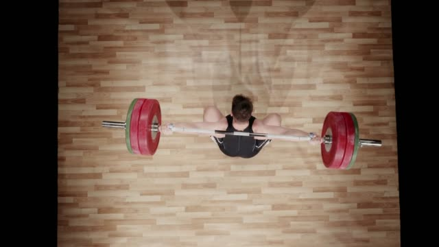 LD Above a male weightlifter failing to perform a snatch lift