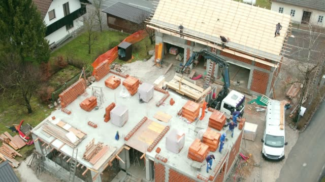 AERIAL Above a private house construction site