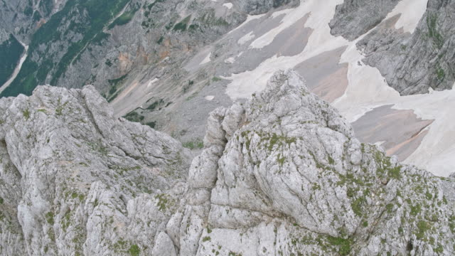 AERIAL Above a rocky mountain