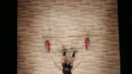 istock LD Above a young female lifter lifting the barbell above her head but falling to the ground backwards 1141156579
