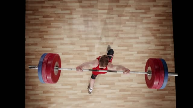 LD Above a young male weightlifter performing the clean and jerk lift