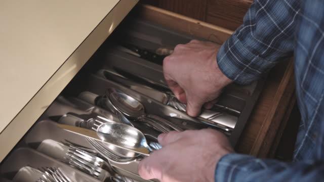 Above Grab Silverware Utensils and Put Away video
