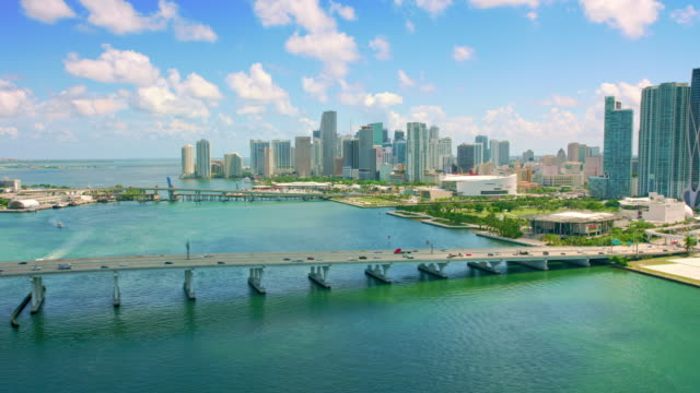 AERIAL Above MacArthur causeway in Biscay bay, Florida