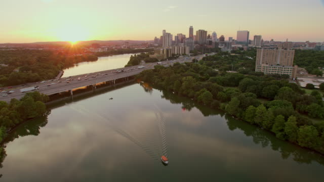 AERIAL Above the Colorado River in Austin, TX, at sunset