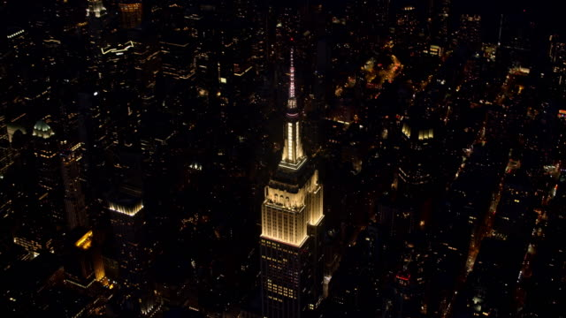 AERIAL Above the Empire State Building shining at night video