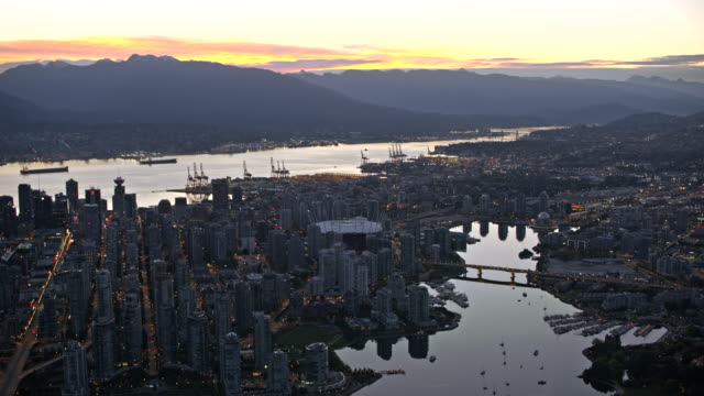 AERIAL Above the False Creek and Vancouver at dusk video