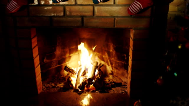 Above the fireplace hangs a burning socks for gifts for Christmas Above the fireplace hangs a burning socks for gifts for Christmas. HD video christmas stocking stock videos & royalty-free footage