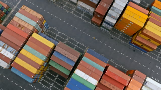 AERIAL Above the high stacks of neatly stacked cargo containers at the terminal