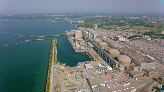 AERIAL Above the Pickering Nuclear Generating Station on the shore of Lake Ontario, Canada