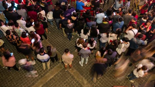 above view time lapse of crowd at night - поститься стоковые видео и кадры b-roll