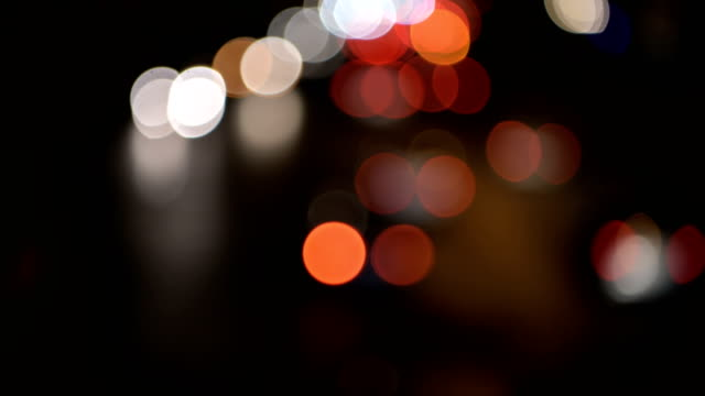 abstact blur bokeh of Evening traffic jam on road in city video