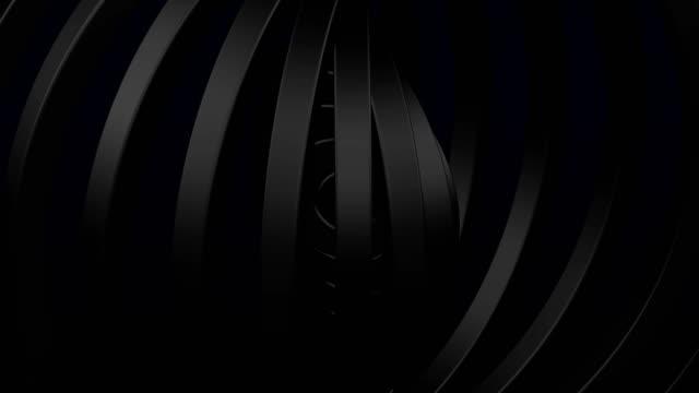abstarct bakgrund - svarta ringar vända. - wheel black background bildbanksvideor och videomaterial från bakom kulisserna