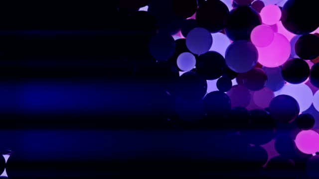 Abstract 3d rendering of pink and blue chaotic motion spheres video