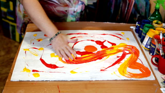 Abstract acrylic intuitive painting process. Woman artist drawing picture video