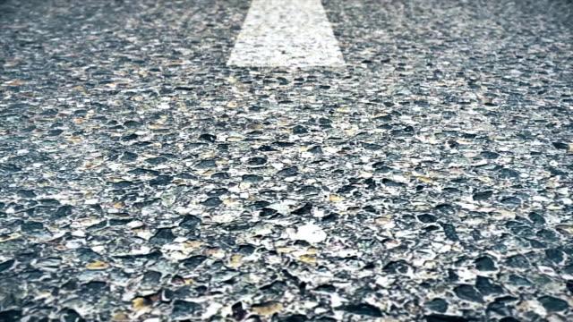 vídeos de stock e filmes b-roll de abstract animation of asphalt. asphalt background. close-up animation of asphalt with markings - alfalto