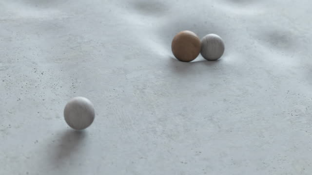 Abstract animation of balls falling on a soft surface and rolling down from it.