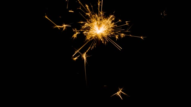 Abstract background closes up to speaking firework on dark background, particle firework for decorating celebrate event, birthday and new year concept. dark frame for effect mapping screen mode.