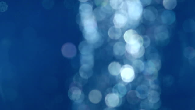 Abstract background loop of flickering particles in blue water video