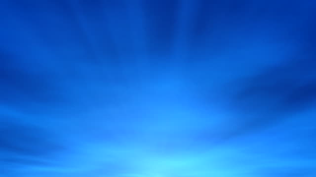 Abstract background - sky (loop) blue abstract background animation of blue sky with sunrays and flowing clouds; loopable blue background stock videos & royalty-free footage