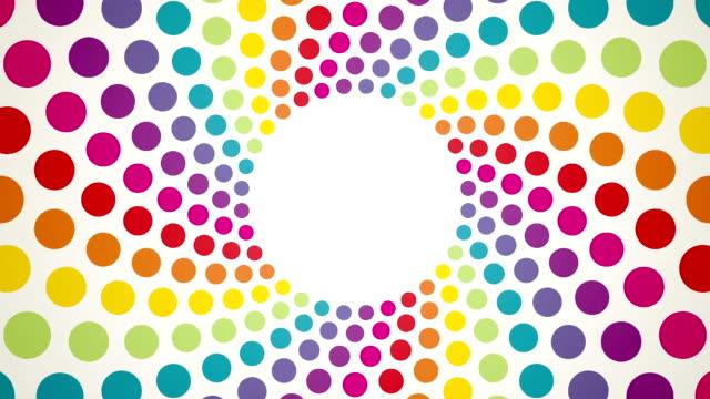 回転の抽象的な背景にカラフルな水玉模様 - 斑点点の映像素材/bロール