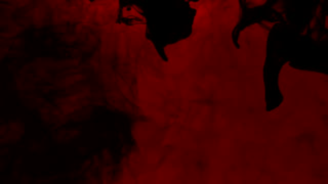 Abstract Black Ink In Water On A Red Background Stock Video