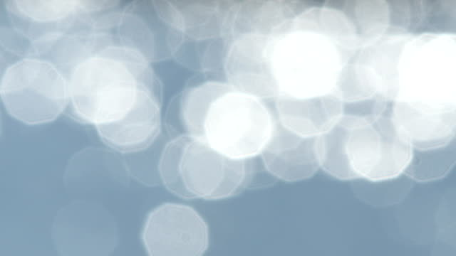 抽象的なブルーの背景とボケ輝く水 ビデオ