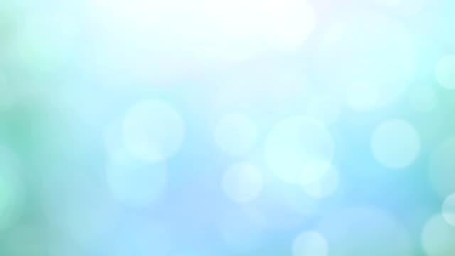 vídeos y material grabado en eventos de stock de abstracto azul luces de fondo desenfocado - sparks