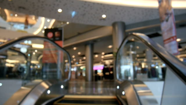 abstract blur shot of moving escalator in shopping mall with bokeh video