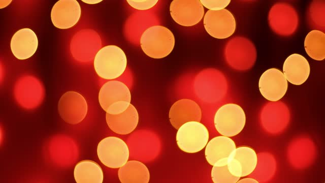 Abstract blurred bokeh lights on red background. Christmas and new year holidays light Abstract blurred bokeh lights on red background. Christmas and new year holidays light low lighting stock videos & royalty-free footage