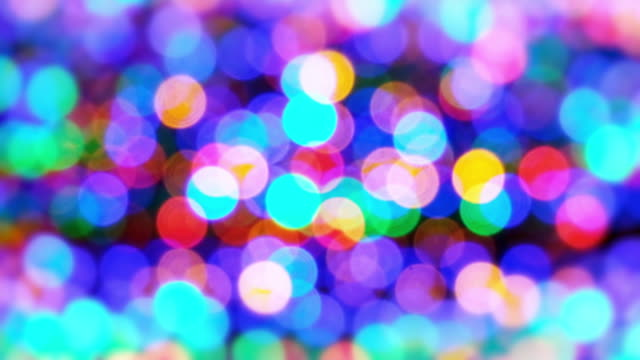Abstract circle Bokeh light pattern shining colorful moving, Christmas and Happy new year festive concept background 4K footage video