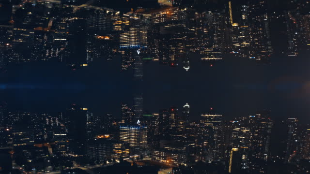 abstract cityscape night background of skyline buildings mirror aerial - узор калейдоскоп стоковые видео и кадры b-roll
