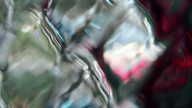 Abstract color reflection on rhombus diamond pattern glass surface Abstract creative background. Blurred beautiful moving colors reflected on the glass of rhombus shaped diamond pattern. jul stock videos & royalty-free footage