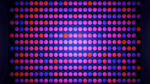 Abstract composition of colorful balls in plane, which randomly light up and reflect in each other. Multicolored spheres like leds as simple geometric dark background with light effects. video