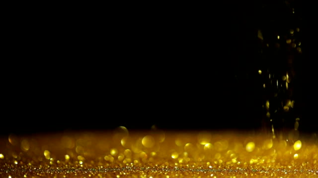 Abstract falling gold glitter background