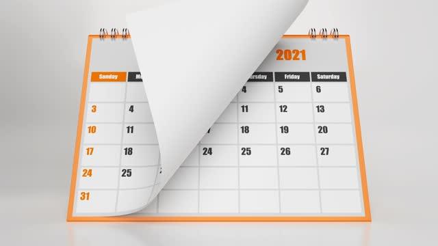 vídeos y material grabado en eventos de stock de páginas voladoras abstractas del calendario 2021 con marco naranja sobre fondo blanco - calendar