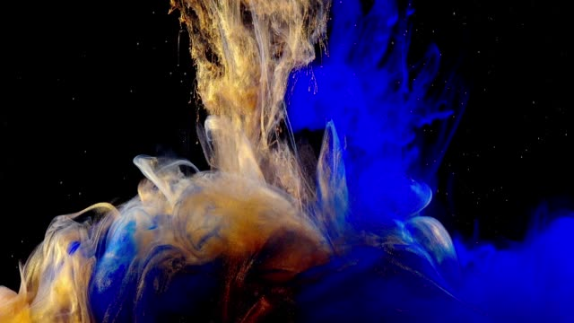 Abstract forms. Shooting on a black background. Mixing of paints. video