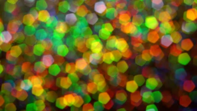 Abstract glowing lights background. Macro. Luminosity hologram glitter sparkles video